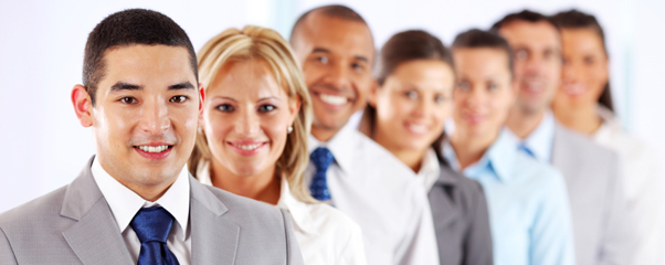 Multiracial businesspeople standing in a row and looking at camera.